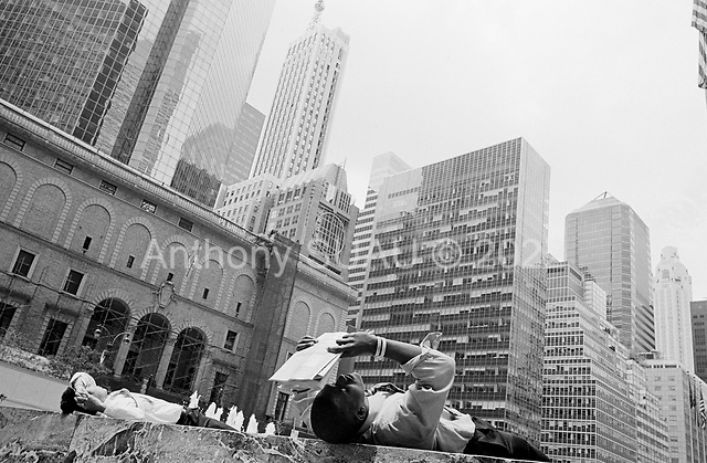 New York, New York<br /> USA<br /> May 2010<br /> <br /> Businessmen take a break in the mid-day sun on Park Avenue where many US and foreign banks have their headquarters - such as JP Morgan, Wachovia, CapitalOne, Citibank are just a few that are there.