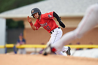Batavia Muckdogs J.D. Orr (22) looks to home on a stolen base attempt during a NY-Penn League game against the Lowell Spinners on July 11, 2019 at Dwyer Stadium in Batavia, New York.  Batavia defeated Lowell 5-2.  (Mike Janes/Four Seam Images)
