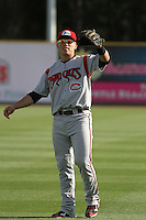 Carolina Mudcats shortstop Tony Wolters #11 throwing in the outfield before the first game of a doubleheader against the Myrtle Beach Pelicans at Tickerreturn.com Field at Pelicans Ballpark on May 10, 2012 in Myrtle Beach, South Carolina. Myrtle Beach defeated Carolina by the score of 2-1. (Robert Gurganus/Four Seam Images)