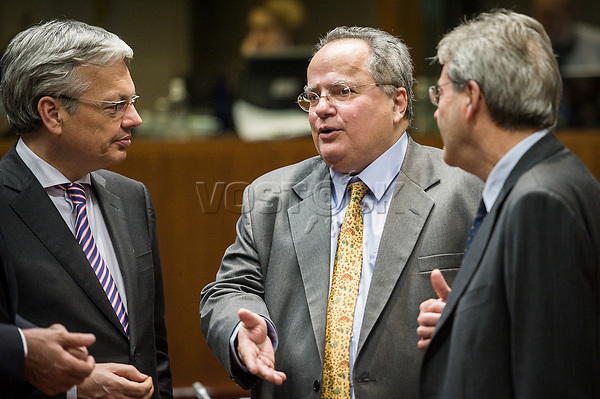 (L-R)  Didier Reynders, Greek Foreign Minister Nikos Kotzias and Italian Minister for Foreign Affairs and International Cooperation Paolo Gentiloni   prior to the European Union Foreign Ministers Council at EU headquarters  in Brussels, Belgium on 29.01.2015 Federica Mogherini , EU High representative for foreign policy called extraordinary meeting on the situation in Ukraine after the attack on Marioupol.  by Wiktor Dabkowski