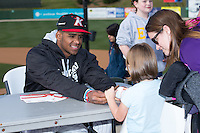 Kannapolis Intimidators outfielder Louis Silverio (8) signs an autograph for a young fan prior to the game against the Hickory Crawdads at Kannapolis Intimidators Stadium on April 10, 2016 in Kannapolis, North Carolina.  The Intimidators defeated the Crawdads 10-3.  (Brian Westerholt/Four Seam Images)