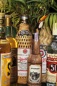 Brazil. Bottles of Cachaca (pure sugar cane alcohol), showing their labels.