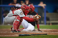 Auburn Doubledays catcher Luis Vilorio (25) fields a throw as Yuniel Ramirez (43) slides in safely behind him during a game against the Batavia Muckdogs on September 5, 2015 at Dwyer Stadium in Batavia, New York.  Batavia defeated Auburn 6-3.  (Mike Janes/Four Seam Images)
