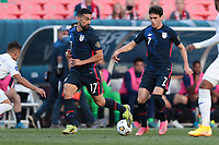 DENVER, CO - JUNE 3: Giovanni Reyna #7 and Sebastian Lletget #17 of the United States move towards the box during a game between Honduras and USMNT at EMPOWER FIELD AT MILE HIGH on June 3, 2021 in Denver, Colorado.