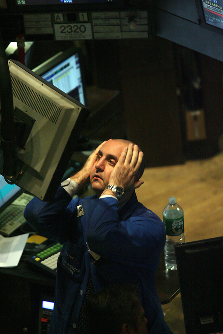 """NEW YORK CITY - September 16, 2008: New York Stock Exchange floor trader appears quite dismayed during late afternoon trading. One trader said that """"volume is low and morale is low"""".  Wall St.  Newsday/Ari Mintz  9/16/2008."""