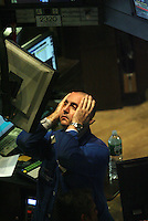 "NEW YORK CITY - September 16, 2008: New York Stock Exchange floor trader appears quite dismayed during late afternoon trading. One trader said that ""volume is low and morale is low"".  Wall St.  Newsday/Ari Mintz  9/16/2008."