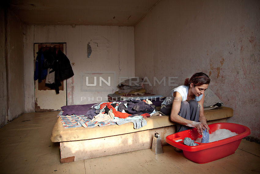 The residence of Lunik IX, young mother cleans and cooks for the family.