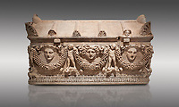 "Picture of Roman relief sculpted Sarcophagus of Garlands, 2nd century AD, Perge. This type of sarcophagus is described as a ""Pamphylia Type Sarcophagus"". It is known that these sarcophagi garlanded tombs originated in Perge and manufactured in the sculptural workshops of Perge. Antalya Archaeology Museum, Turkey.. Against a grey background."