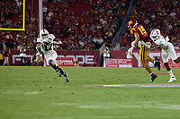 LOS ANGELES, CA - SEPTEMBER 11: Kyu Blu Kelly #17 of the Stanford Cardinal intercepts a pass intended for Drake London #15 of the USC Trojans and runs it in for a touchdown during a game between University of Southern California and Stanford Football at Los Angeles Memorial Coliseum on September 11, 2021 in Los Angeles, California.