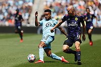 ST PAUL, MN - JULY 18: DJ Taylor #26 of Minnesota United FC and Brad Smith #11 of the Seattle Sounders FC battle for the ball during a game between Seattle Sounders FC and Minnesota United FC at Allianz Field on July 18, 2021 in St Paul, Minnesota.