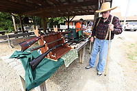 Charlie Caywood of War Eagle shows Sept. 24 2021 some of the black powder rifles he's built. Caywood celebrated his 90th birthday with friends at the muzzle-shoot. He's still making guns. <br />(NWA Democrat-Gazette/Flip Putthoff)