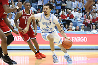 CHAPEL HILL, NC - FEBRUARY 25: Cole Anthony #2 of the University of North Carolina drives with the ball during a game between NC State and North Carolina at Dean E. Smith Center on February 25, 2020 in Chapel Hill, North Carolina.