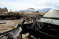 The remain of the Lincolm, R&R Phantom III and the Ziz 110 in the destroy UNESCO bunker, in the courtyard of the Afghan Kabul National museum in Spring 1995. On the back left, the destroy Darulaman Palace.