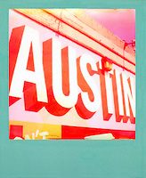 """Polaroid instant film picture of """"Austin"""" mural in downtown Austin, Texas - Stock Image."""