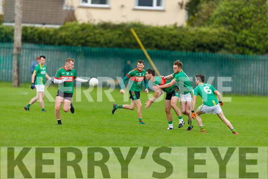 Beales Jeremy King off loads the ball under pressure from  Castlegregory's Tadhg Ó Muireartaigh and Seán SeosamhÓ hEosa to his team mate Ian Mannix in the Junior Football Championship semi final