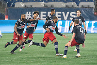 FOXBOROUGH, MA - NOVEMBER 1: Teal Bunbury #10 of New England Revolution runs with his team mates to celebrate his second goal of the night during a game between D.C. United and New England Revolution at Gillette Stadium on November 1, 2020 in Foxborough, Massachusetts.