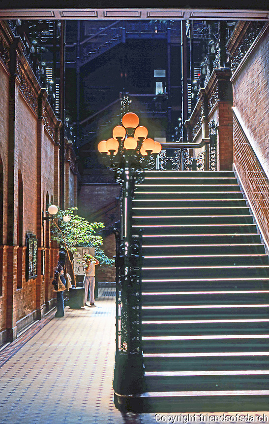Los Angeles: Bradbury Building. Interior from Entrance. Wrought-iron stairs, brick walls. natural light. Photo '78.