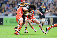 Ashley Johnson of Wasps is slowed down by Ben Youngs and Adam Thompstone of Leicester Tigers