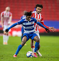 6th February 2021; Bet365 Stadium, Stoke, Staffordshire, England; English Football League Championship Football, Stoke City versus Reading; Omar Richards of Reading under pressure from Jacob Brown of Stoke City