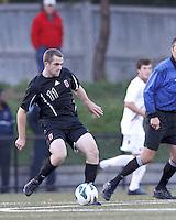 Brown University midfielder Jack Kuntz (11) passes the ball. Brown University (black) defeated Boston College (white), 1-0, at Newton Campus Field, October 16, 2012.
