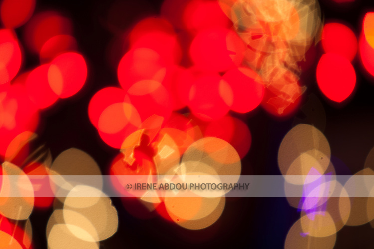 """At a holiday light display (Brookside Gardens Garden of Light in Wheaton, Maryland), patterns of light are created by """"de-focusing"""" the camera."""