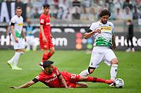 23rd May 2020, BORUSSIA-PARK, North Rhine-Westphalia, Germany; Bundesliga football, Borussia Moenchengladbach versus Bayer Leverkusen; <br /> Kerem Demirbay (Leverkusen) with a sliding tackle on  Tobias Strobl (BMG)