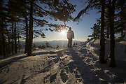 Silhouette of a male hiker on Mount Tecumseh in Waterville Valley, New Hampshire during the spring months. Named for the Shawnee chief Tecumseh (1768–1813), this mountain is part of the White Mountain National Forest.
