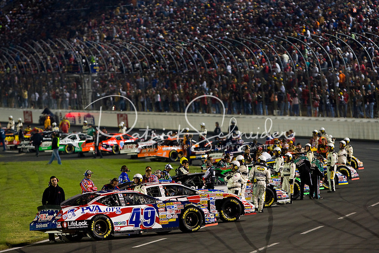 Drivers wait to enter their car prior to the start of the Bank of America 500 NASCAR race at Lowes's Motor Speedway in Concord, NC.