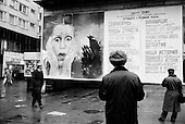 """Moscow, Russia<br /> October 1992<br /> <br /> People search out Moscow entertainment information on a bill board along the Arbat in central Moscow.<br /> <br /> In December 1991, food shortages in central Russia had prompted food rationing in the Moscow area for the first time since World War II. Amid steady collapse, Soviet President Gorbachev and his government continued to oppose rapid market reforms like Yavlinsky's """"500 Days"""" program. To break Gorbachev's opposition, Yeltsin decided to disband the USSR in accordance with the Treaty of the Union of 1922 and thereby remove Gorbachev and the Soviet government from power. The step was also enthusiastically supported by the governments of Ukraine and Belarus, which were parties of the Treaty of 1922 along with Russia.<br /> <br /> On December 21, 1991, representatives of all member republics except Georgia signed the Alma-Ata Protocol, in which they confirmed the dissolution of the Union. That same day, all former-Soviet republics agreed to join the CIS, with the exception of the three Baltic States."""