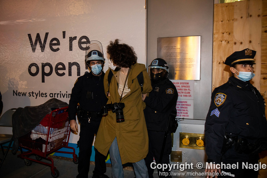 NYPD police officers arrest a photographer during a protest demanding every vote cast be counted in the 2020 presidential election between U.S. President Donald Trump and former Vice President Joe Biden on November 4, 2020 in New York City.  Photograph by Michael Nagle