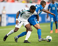 DENVER, CO - JUNE 19: Aricheell Hernandez #10 and Joris Marveaux #3 contest the ball during a game between Martinique and Cuba at Broncos Stadium on June 19, 2019 in Denver, Colorado.
