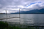 A small dock extends from the shore of Lake Quinault, Olympic Penninsula, Washington.  Lake Quinault belongs to the Quinault Indian Nation, and is bordered by Nation, Forest Service, and Olympic National Park lands. Olympic Peninsula