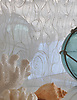 Octopus's Garden, a jewel glass waterjet mosaic, is shown in Moonstone.