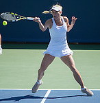 Caroline Wozniacki (DEN) defeats Agnieszka Radwanska (POL) 6-4, 7-6(5) at the Western & Southern Open in Mason, OH on August 15, 2014.