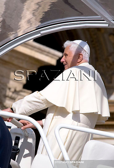 Pope Benedict XVI waves as he leaves his weekly general audience on October 21, 2009 at St Peter's square at The Vatican.