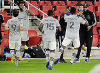 WASHINGTON, DC - NOVEMBER 8: Victor Wanyama #2 of Montreal Impact celebrates his score with Thierry Henry Head Coach of Montreal Impact during a game between Montreal Impact and D.C. United at Audi Field on November 8, 2020 in Washington, DC.