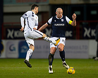 29th December 2020; Dens Park, Dundee, Scotland; Scottish Championship Football, Dundee FC versus Alloa Athletic; Kevin Cawley of Alloa Athletic challenges for the ball with Charlie Adam of Dundee