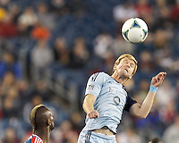 Sporting Kansas City forward Jacob Peterson (37) heads the ball.  In the first game of two-game aggregate total goals Major League Soccer (MLS) Eastern Conference Semifinal series, New England Revolution (dark blue) vs Sporting Kansas City (light blue), 2-1, at Gillette Stadium on November 2, 2013.