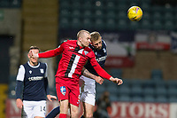 27th March 2021; Dens Park, Dundee, Scotland; Scottish Championship Football, Dundee FC versus Dunfermline; Craig Wighton of Dunfermline Athletic competes in the air with Christie Elliott of Dundee