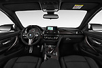 Stock photo of straight dashboard view of a 2018 BMW M4 Base 2 Door Coupe