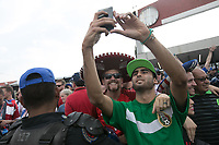 MEXICO CITY, MEXICO - June 11, 2017:  USA and Mexico fans take a photo together before the World Cup Qualifier match against Mexico at Azteca Stadium.