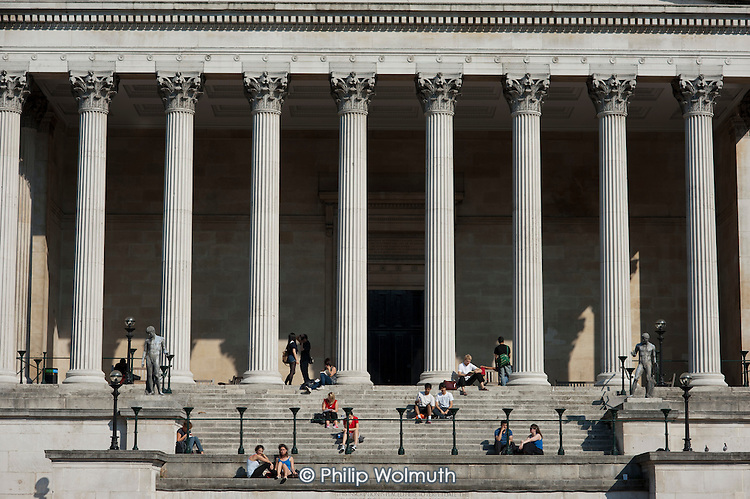 Students take a lunch break in the sunshine at University College London.