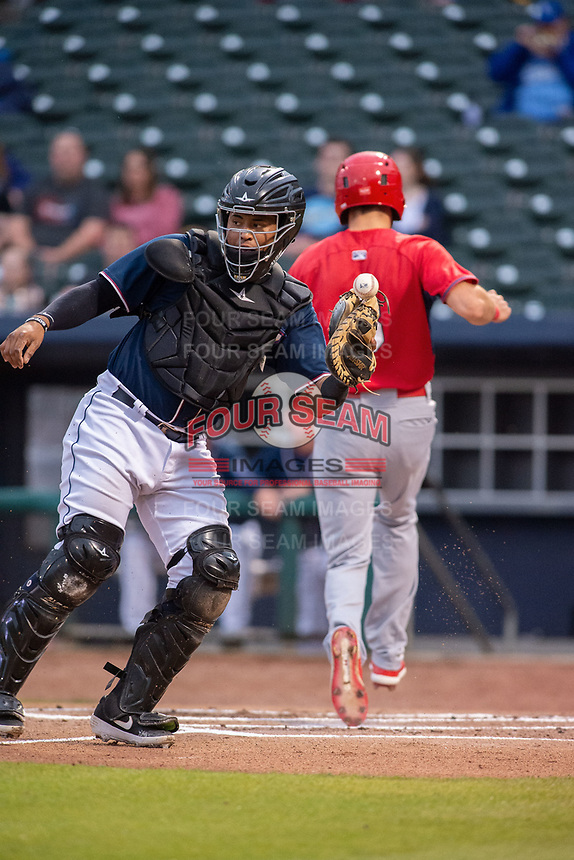 Northwest Arkansas Naturals catcher Meibrys Viloria (22) tries to make a catch on the ball as Springfield Cardinals infielder Dylan Carlson (8) crosses the plate for a run on May 18, 2019, at Arvest Ballpark in Springdale, Arkansas. (Jason Ivester/Four Seam Images)