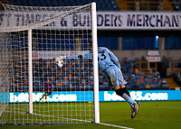 31st October 2020; The Den, Bermondsey, London, England; English Championship Football, Millwall Football Club versus Huddersfield Town; Goalkeeper Bartosz Bialkowski of Millwall attempting to push the ball out but is unsuccessful as Pipa of Huddersfield Town shoots and scores his sides 2nd goal in the 88th minute to make it 0-2