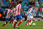 (L-R) Atletico de Madrid's  Filipe Luis, Arda Turan, Diego Godin and Malaga's Diego Ribas during La Liga match. Mayo 5,2012. (ALTERPHOTOS/Arnedo & Alconada)