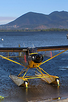 Cubcrafters Carbon Cub on floats, N775VW, taxis onto the Natural High School Ramp at the Clear Lake Seaplane Splash-In, Lakeport, Lake County, California; Mount Konocti is in the background