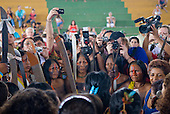 "Altamira, Brazil. ""Xingu Vivo Para Sempre"" protest meeting about the proposed Belo Monte hydroeletric dam and other dams on the Xingu river and its tributaries. Women unite with cameras and video cameras looking on."