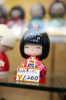 A Japanese figurine on display in a store window in Sensoji, an ancient Buddhist temple, in Tokyo.