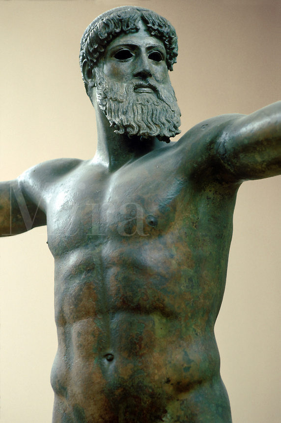 Classical Greek bronze statue of Poseidon or Zeus. Most historians believe the statue represents Poseidon brandishing a trident with his cocked right arm. The sculpture was raised from the sea, off Cape Artemision, in north Euboea. Dated to ca. 460 B.C.
