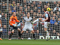 Pictured L-R: Swansea goalkeeper Gerhard Tremmel and team mate Jonjo Shelvey look on as Kevin Nolan of West Ham scores his second goal. 01 February 2014<br />